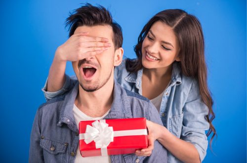 Boyfriend getting Christmas gift from girlfriend