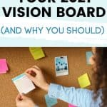woman putting pictures on her vision board
