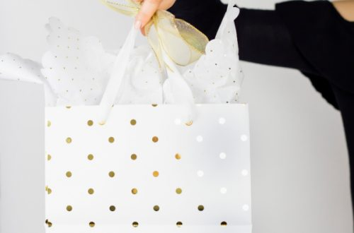 Wife holding gift bag